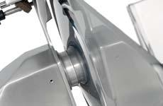Stainless steel screws and slice deflector. Strong thickness gauge support. Cast-in body sharpener assembly with 2 standard emery-wheels.