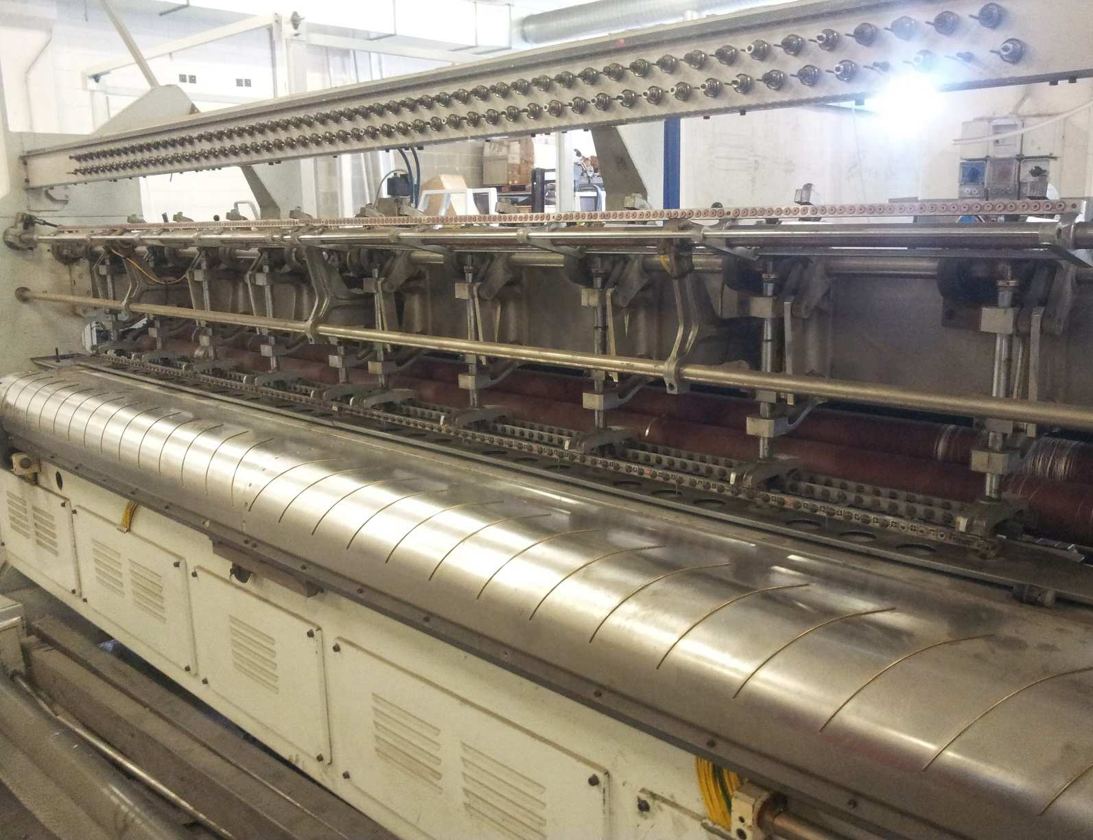 hemming machine, cuts and sews the panels,