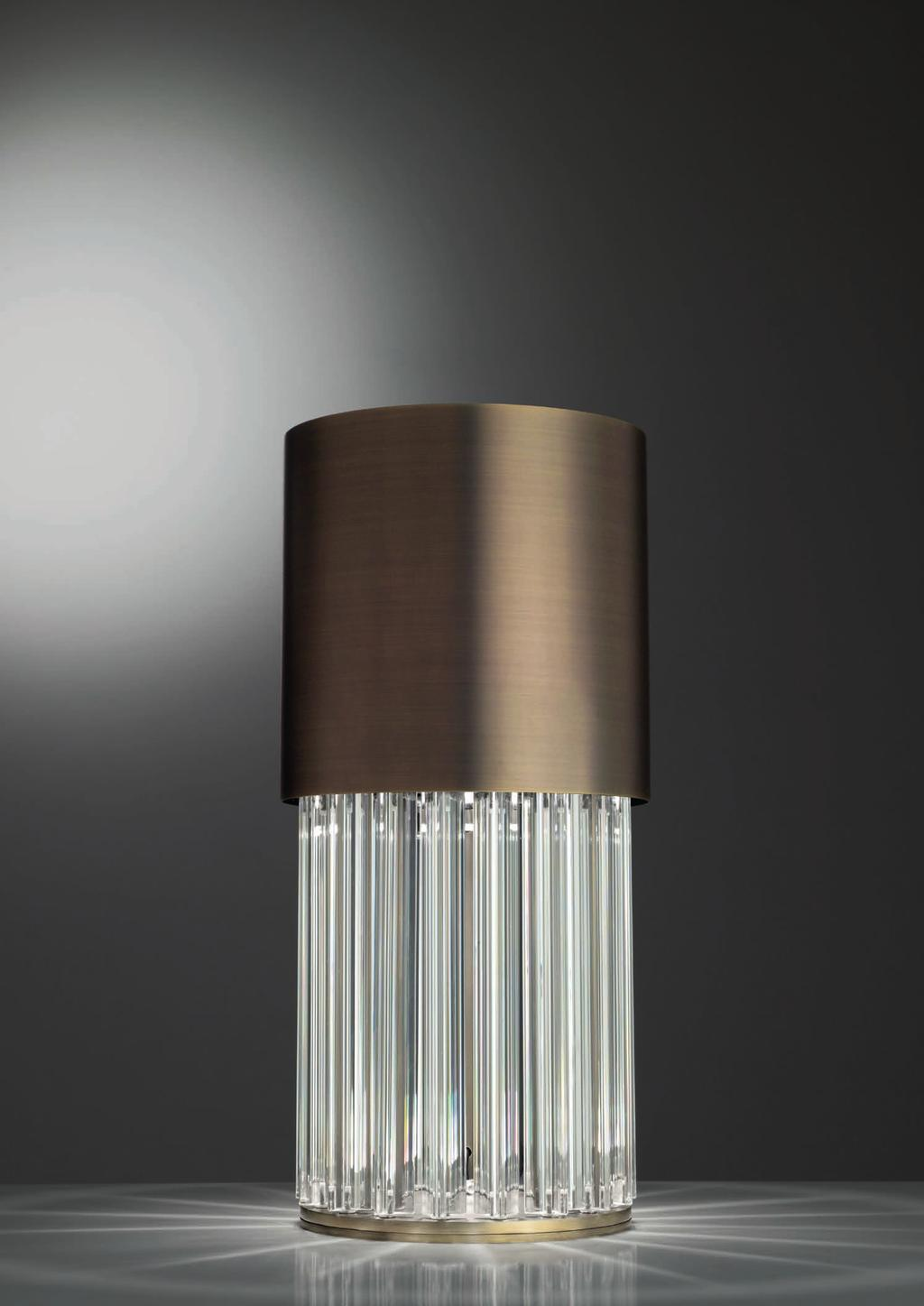 CHIC TABLE 45cm-17 7 Ø 26cm-10 Table lamp with diffuse light. Dark bronze striped structure with crystal, amber or smoke grey trihedrons.