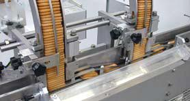 SHUTTLE FEEDER FOR BISCUITS 2-axis shuttle feeder completely servo driven with mechanical pusher with in/out movements driven by cam on eccentrics in order to obtain differentiated intervention time.