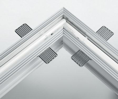 recessed fluorescent modular system suitable for plaster ceiling/wall. Powder coated extruded aluminum body.
